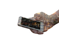 Double exposure of hand hold smartphone over night city. Background Stock Photo