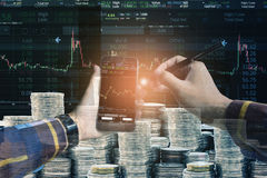 Double exposure of Hand holding blank smart phone checking finan. Cial stats on screen with group of coins and stock background for trading stock concept Stock Images