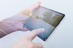 Double exposure, hand holding digital tablet, solar panels on sc Stock Photography