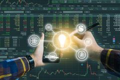 Double exposure of Hand holding smart phone checking financial s. Tats on screen with business tools icon for trading stock concept Royalty Free Stock Photo