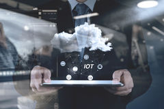 Double exposure of hand showing Internet of things (IoT) word di Royalty Free Stock Photography