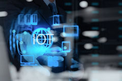 Double exposure of hand showing Internet of things (IoT). Word diagram as concept Stock Photography