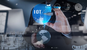 Double exposure of hand showing Internet of things (IoT) Royalty Free Stock Photography