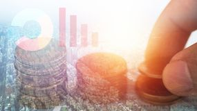 Double exposure of hand stacked pile coin money and city with account book finance and banking concept for background.concept in g. Row and walk step by step for Stock Photography