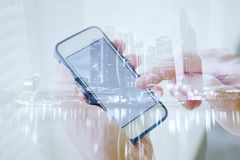 Double exposure of hands with smart phone, modern technology. Of mobile application Stock Image