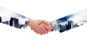 Double exposure handshake of businessmen Stock Photos