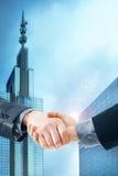 Double exposure handshake of businessmen Stock Images