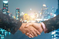 Double exposure of handshake and city royalty free stock photos
