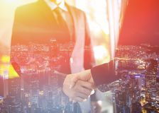Double exposure of handshake and city, Business handshake and business people stock photos