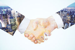 Double exposure with a handshake between two businessmen Stock Photography
