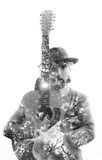 Double exposure of a handsome, older guitar player with hipster Stock Image