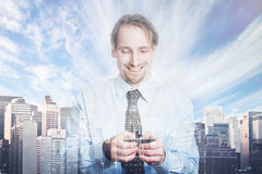 Double exposure of happy successful businessman using smart phone business stock photography