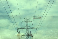 Double exposure high voltage power lines with boats on ocean background Royalty Free Stock Photography