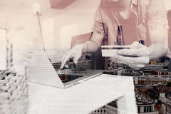 double exposure of hipster hand using laptop compter,holding cra Stock Photos