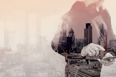 Double exposure of hooded man hipster with headphones listening. To music with smart phone mobile payment online shopping,social network,front view,London Stock Photo