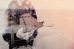Double exposure of hooded man hipster with headphones listening. To music with smart phone mobile payment online shopping,social network,front view,London Royalty Free Stock Images