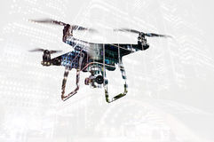 Double exposure. Hovering drone and city at night. Isolated. Royalty Free Stock Photo