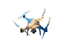 Double exposure. Hovering drone and sky with clouds. Isolated. Double exposure. Close up of hovering drone taking pictures of sky with clouds on sunset Stock Image