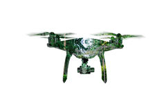 Double exposure. Hovering drone taking pictures of green trees. Royalty Free Stock Photo