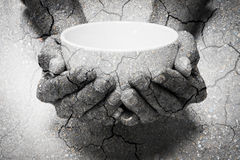 Double exposure hunger begging hands and dry soil. Represent that lot of people in the world are hungry and starvation, they need help and hope for better life royalty free stock photo