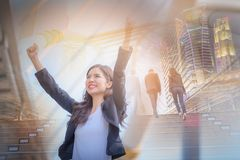 Double exposure image of business woman smiling with arms up cel. Ebrate on blurred city background. Business success concept stock photography