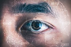The double exposure image of the businessman`s eye overlay with futuristic hologram. stock photo