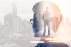 The double exposure image of the businessman thinking during sunrise overlay with cityscape image. The concept of modern life, bus. Iness, city life and internet stock images