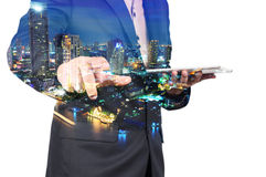 Double Exposure image of Businessman use Digital Tablet and City Royalty Free Stock Photo
