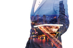Double Exposure image of Businessman use Digital Tablet and City Royalty Free Stock Image
