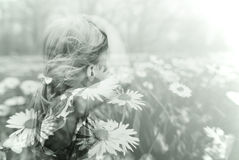 Double exposure image of a little blonde girl and spring meadow