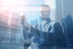 Double exposure image man making photo smartphone.Picture bearded trader manager in modern office panoramic view Stock Photography