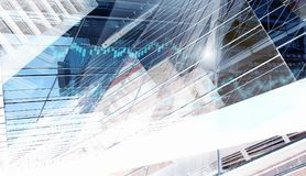 Business and finance background . Mixed media. Double exposure image with modern buildings and graphs . Mixed media Stock Photos