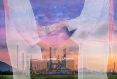 Double exposure image of oil refinery plant and businessman hand stock photos