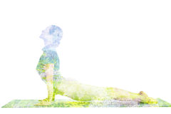 Double exposure image of woman doing yoga asana stock images