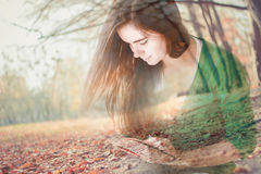 Double exposure image of woman reading a book in the park Stock Photo