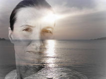 Double exposure image of a young woman and seascape Royalty Free Stock Images