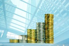 Double exposure of increasing columns of coins, step of stacks c Stock Images