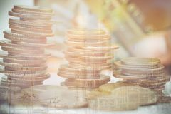 Double exposure of industrial and rows of coins. For finance and banking concept Royalty Free Stock Photography