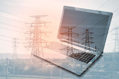 Double exposure laptop with blur power plant. Background stock photos