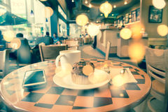 Double exposure latte coffee. Made with vintage tones, blur coffee shop background Stock Image