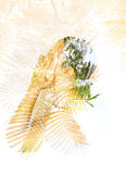 Double exposure of leaves in the beautiful young woman Stock Photography