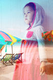 Double exposure of little girl dreaming about beach Royalty Free Stock Photo