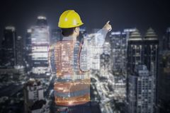 Double exposure of male engineer with skyscraper royalty free stock photo