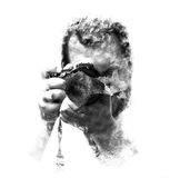 Double exposure male photographer looking at the camera, black and white. Stock Images