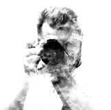 Double exposure male photographer looking at the camera. Stock Photography