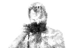 Double exposure male photographer looking at the camera, black and white silhouette Stock Image