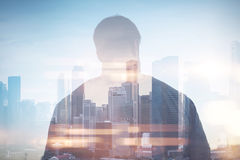 Double exposure of man and city on the background Stock Photo