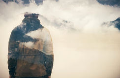 Double Exposure of Man and Cloudy Mountains forest Royalty Free Stock Photography