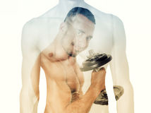 Double exposure of man with dumbbell and male torso. Double exposure of male torso and man working out with dumbbell Royalty Free Stock Photos