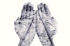 Double exposure of man hands and railway, in black and white. Double exposure of the palms of a man put together and a railway, in black and white Royalty Free Stock Photography